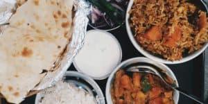 chicken tikka masala, lamb biryani, butter naan, potato and pea samosas