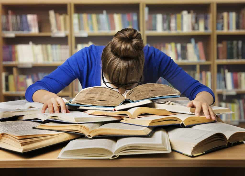 student-studying-sleeping-on-books-tired-girl-read-book-library